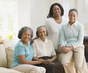 Multi-generational African women sitting on sofa