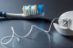Close up of toothbrush and dental floss